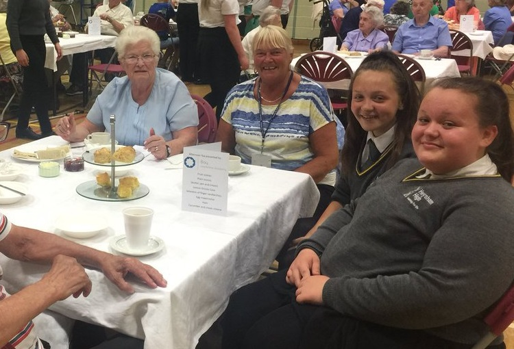 Students host afternoon tea for elderly residents
