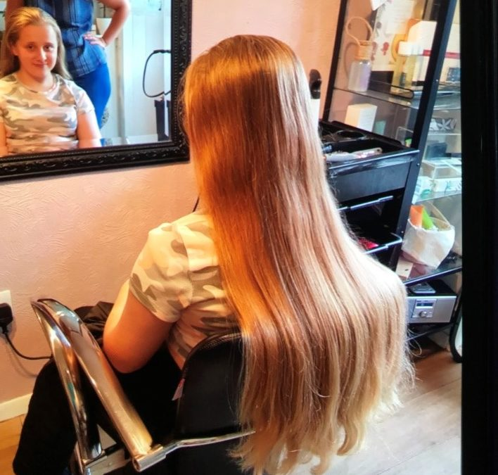 Pupil donates hair to children with cancer.